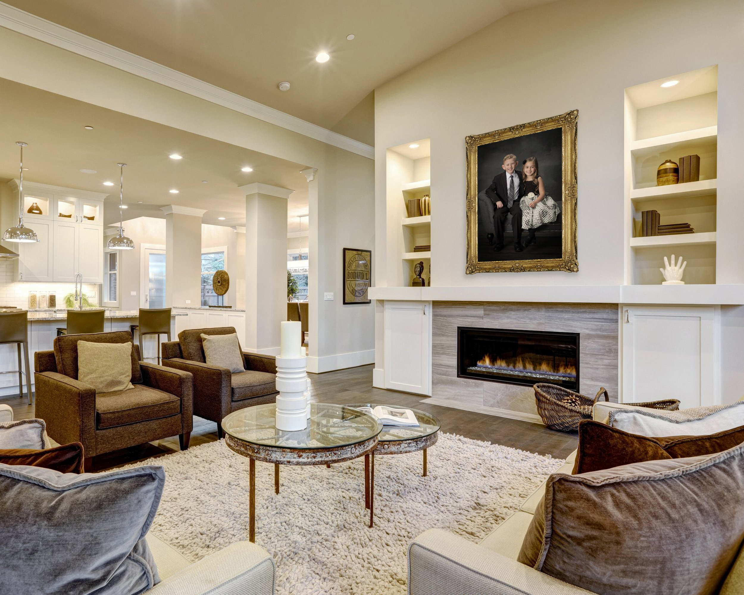 Chic living room design in natural colors and open plan. Furnished with glass top accent tables and beige sofas topped with brown pillows facing modern fireplace with built-in shelves. Northwest, USA